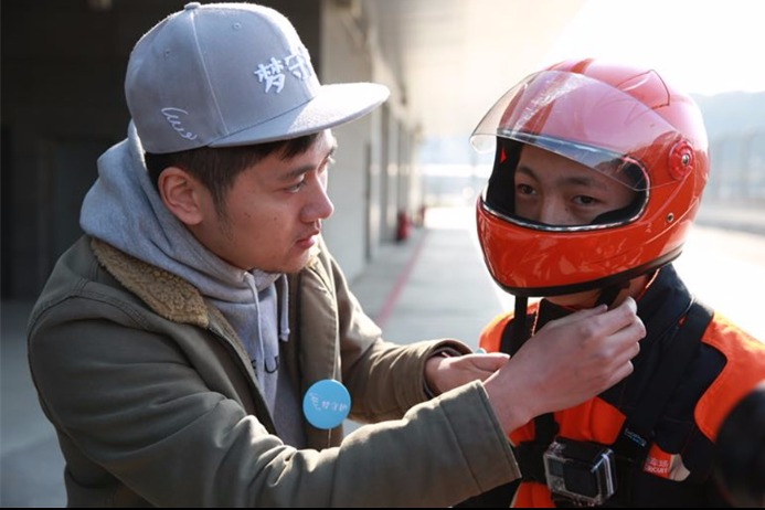 NGO helps epileptic boy realize racing dream in Zhejiang