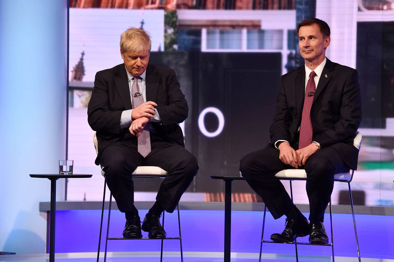 © Reuters. Boris Johnson and Jeremy Hunt appear on BBC TV