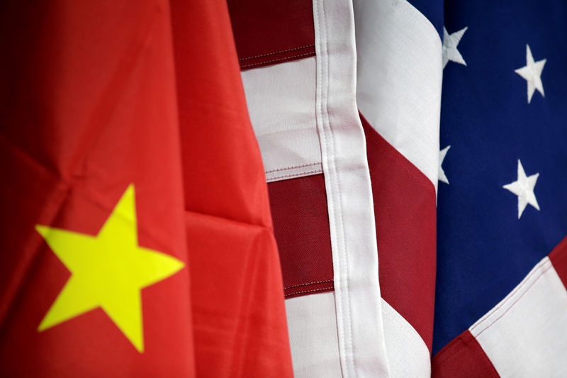 © Reuters. FILE PHOTO: Flags of U.S. and China are displayed at AICC