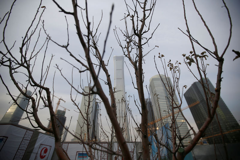 © Reuters. A tree is pictured in front of buildings in Beijing