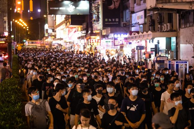 © Bloomberg. Demonstrators march on Nathan Road during a protest in the Mong Kok district of Hong Kong, China, on Sunday, July 7, 2019. Thousands of demonstrators chanting slogans marched through one of Hong Kong