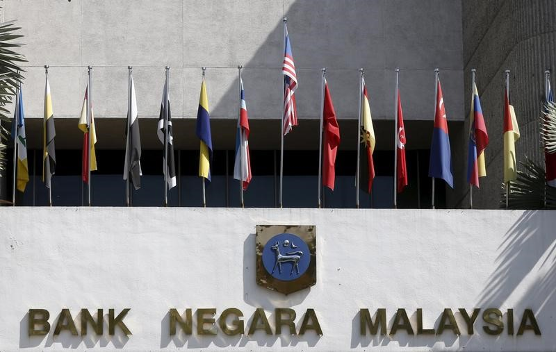 Malaysia's central bank seen holding rates to assess economic risks: Reuters poll By Reuters