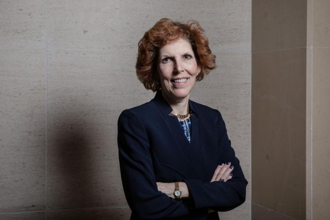 "© Bloomberg. Loretta Mester, president of the Federal Reserve Bank of Cleveland, poses for a photograph following a Bloomberg Television interview at the French central bank and Global Interdependance Center (GIC) conference in Paris, France, on Monday, May 14, 2018. European Central Bank policy maker Francois Villeroy de Galhau said the first interest-rate increase could come ""some quarters, but not years"" after policy makers end their bond-buying program."