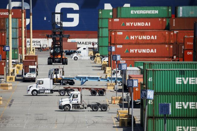 © Bloomberg. Semi-trucks wait to be loaded with shipping containers in the APM shipping terminal at the Port of Los Angeles in Los Angeles, California, U.S., on Tuesday, May 7, 2019. The terminal is planning to replace diesel trucks and human workers. It has already ordered an electric, automated carrier from Finnish manufacturer Kalmar, part of the Cargotec Corp., that can fulfill the functions of three kinds of manned diesel vehicles: a crane, top-loader and truck. Photographer: Patrick T. Fallon/Bloomberg