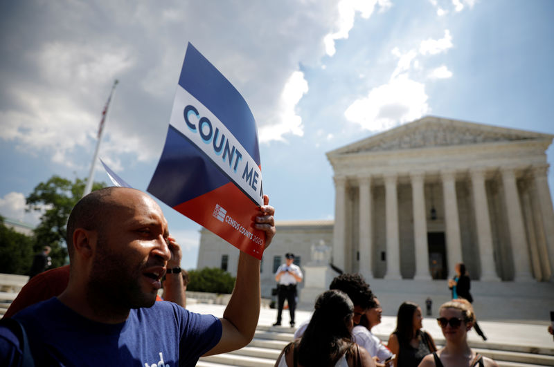© Reuters. FILE PHOTO: A protester holds sign outside the U.S. Supreme Court in Washington