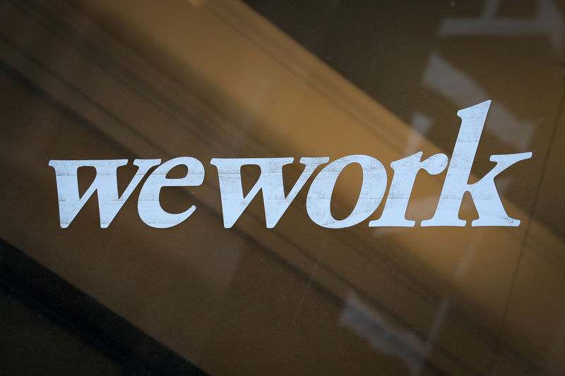 © Reuters. The WeWork logo is displayed on the entrance of a co-working space in New York