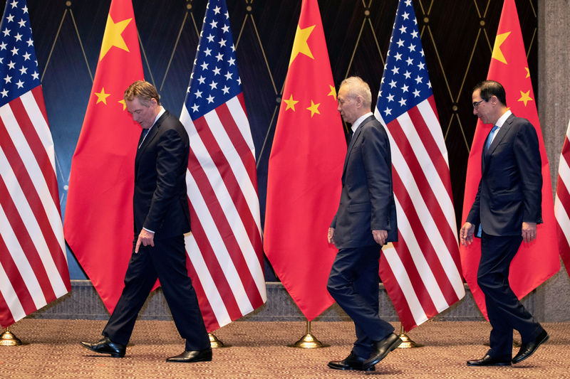China vows fight against Trump's latest tariffs as stocks sink By Reuters