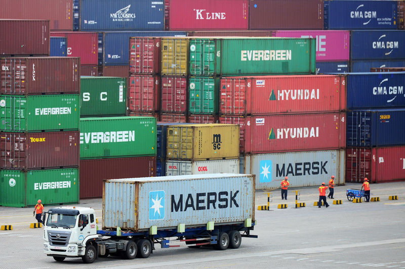 China's July exports seen falling again, import slump to deepen: Reuters poll By Reuters