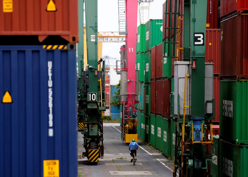 Japan exports slide for eight month on weak global demand By Reuters