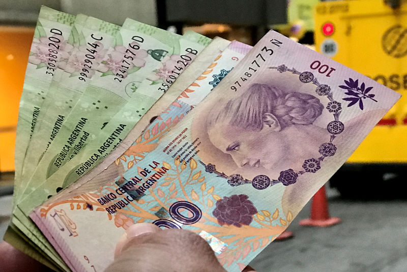 Argentina's $15 billion dollar burn stems peso rout: for now By Reuters