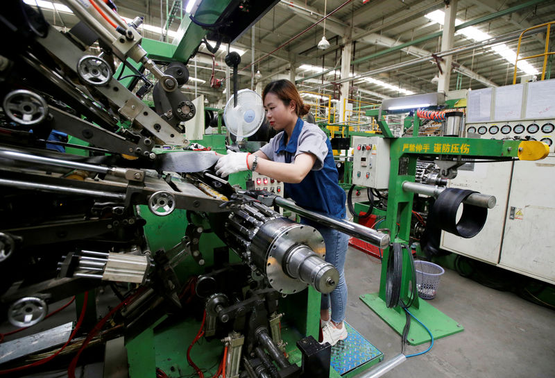 Asian factories lashed by trade wars, slowing demand in August By Reuters