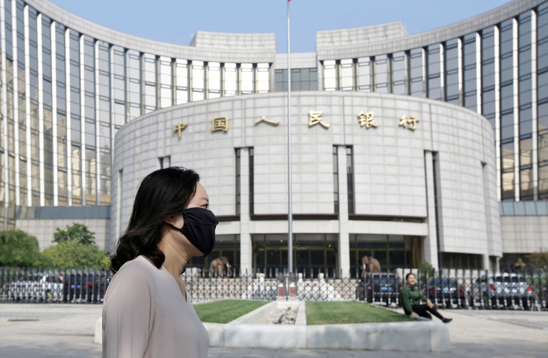 China slashes banks' reserve ratios to boost lending as economy slows By Reuters