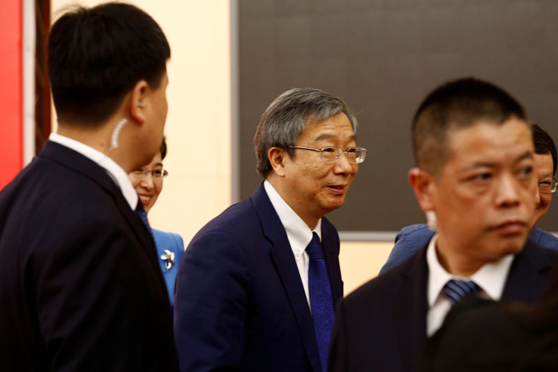 © Reuters. Governor of PBOC Yi Gang leaves at the end of a news conference on China