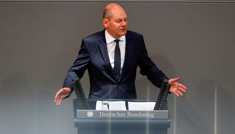 German savers need not reckon with negative interest rates: Scholz By Reuters