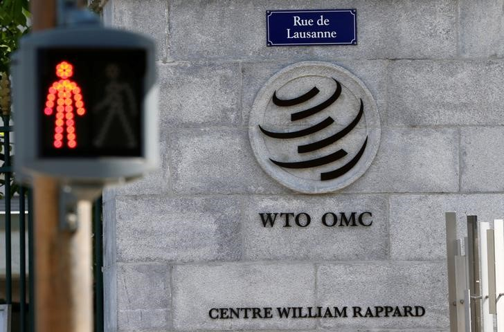 © Reuters.  Global services trade slows but stronger than goods: WTO