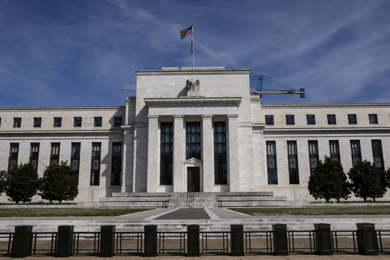 To cut or not? Dueling Fed views boost pressure on Powell By Reuters