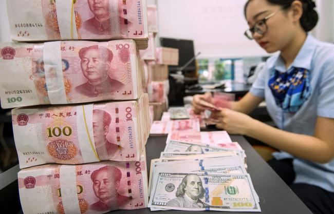 Trump's Trade War Pits Mnuchin Against IMF Over China's Yuan By Bloomberg
