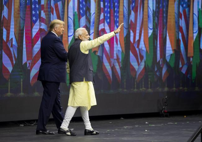 Trump and Modi Hand-in-Hand on Border Security at U.S. Rally By Bloomberg