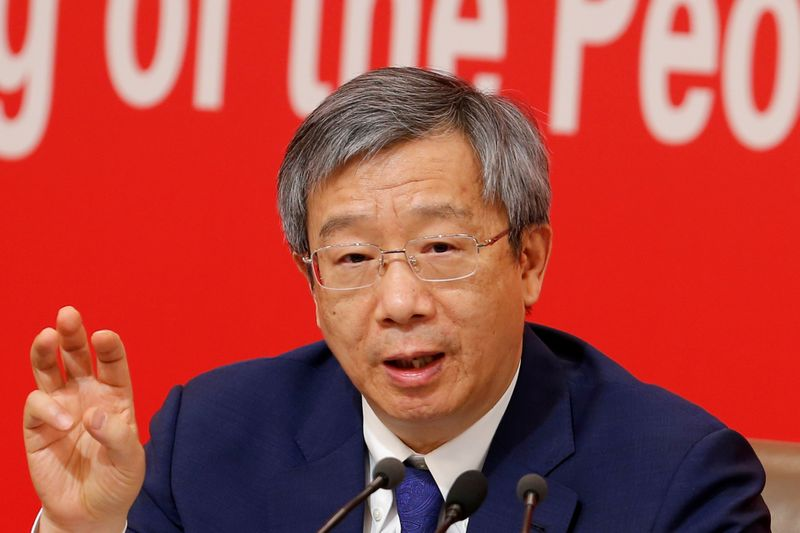 © Reuters. Governor of People's Bank of China (PBOC) Yi Gang attends a news conference on China's economic development ahead of the 70th anniversary of its founding, in Beijing