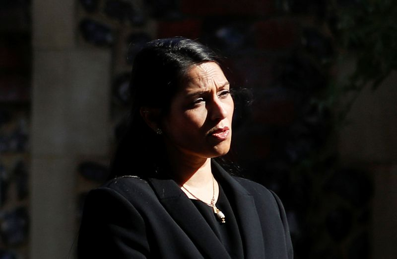© Reuters. Britain's Home Secretary, Priti Patel, speaks to the media near to the scene of reported multiple stabbings in Reading