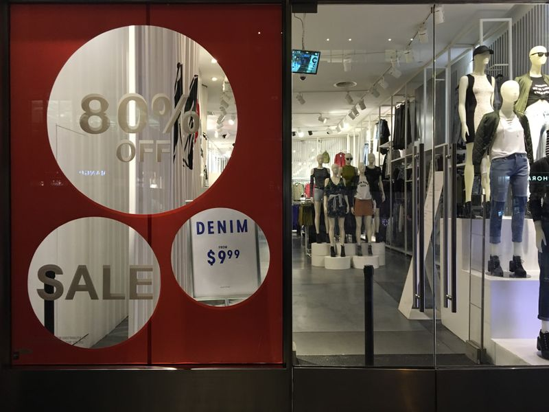 © Reuters. An H&M store has sale signs in the window in New York City