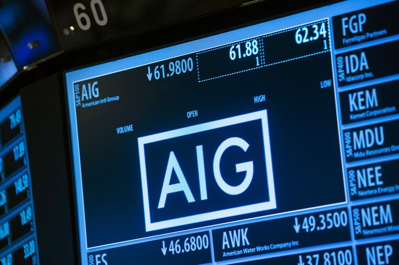 © Reuters. Current information related to insurance company AIG is displayed above the floor of the New York Stock Exchange