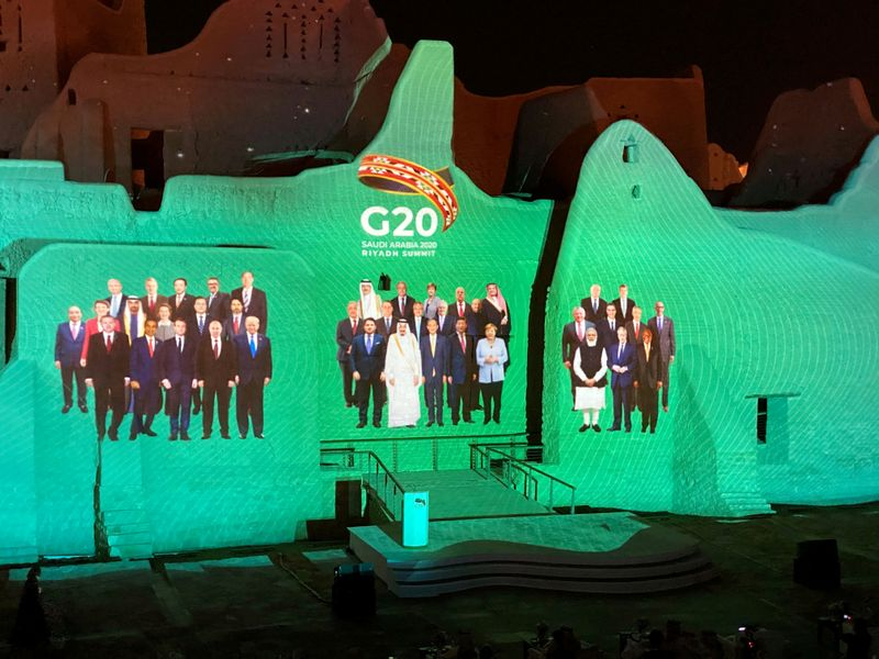 © Reuters. FILE PHOTO: Family Photo of G20 Leaders' Summit is projected onto Salwa Palace in At-Turaif, in Diriyah