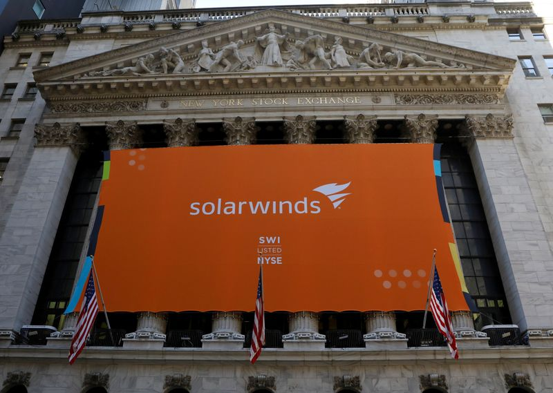 © Reuters. FILE PHOTO: SolarWinds Corp. banner hangs on the company's IPO at the NYSE in New York