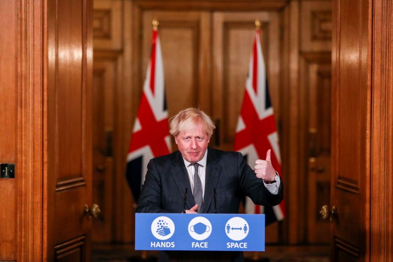 © Reuters. Britain's PM Johnson holds a news conference at Downing Street in London